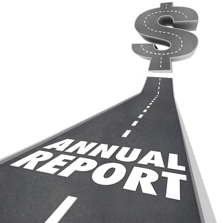 Annual Report words on a road going up to a dollar sign to illustrate growing financial results or performance Stock Photo