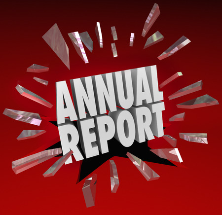 Annual Report words break through glass to illustrate a surprise or shocking financial results or growth in money earned, profits and revenue Stock Photo