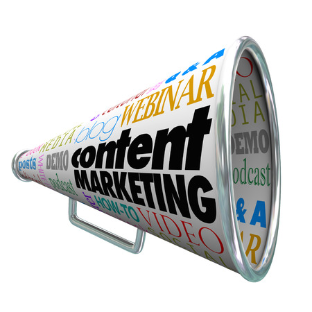 content writing: Content Marketing words on a bullhorn or megaphone to illustrate customer and prospect outreach and communication from a business or company