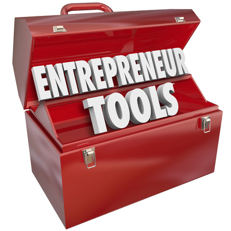 red metal: Entrepreneur Tools words in a red metal toolbox to illustrate help, information, tips and advice for growing your business ownership skills and knowledge for success Stock Photo