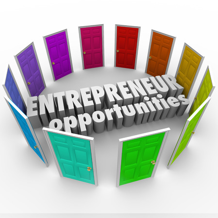 path to wealth: Entrepreneur Opportunities words in the middle of many colored doors to illustrate the wide array of business paths, directions and choices surrounding you
