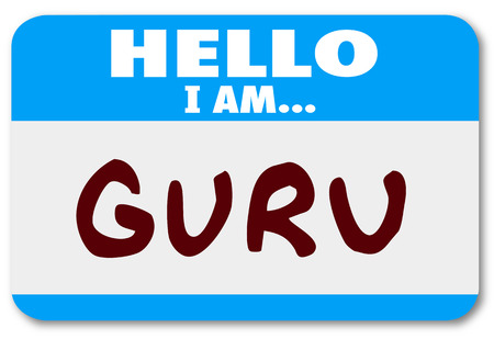 nametag: Guru name written on a blue name tag sticker to tell others you are a teacher, guide, mentor, expert or consultant in your area of expertise Stock Photo