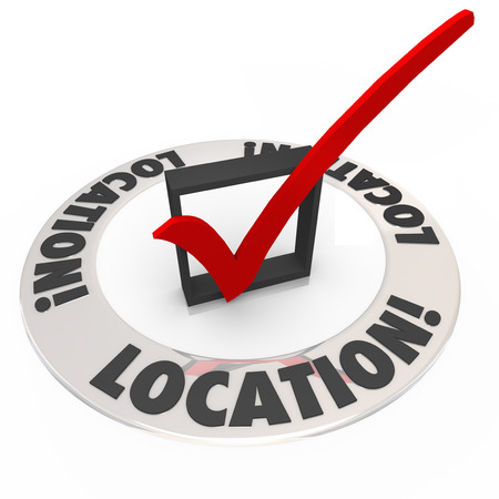 best location: Location word on ring around check box and mark to illustrate the importance of making choosing the best place, area or neighborhood a top priority Stock Photo