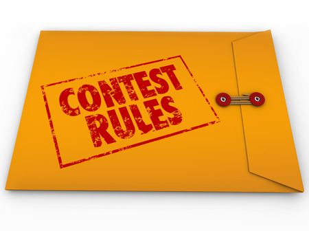 vying: Contest Rules words stamped on a yellow envelope to illustrate terms and conditions for a raffle, competition, prize drawing or other challenge that will award a jackpot to a winner Stock Photo
