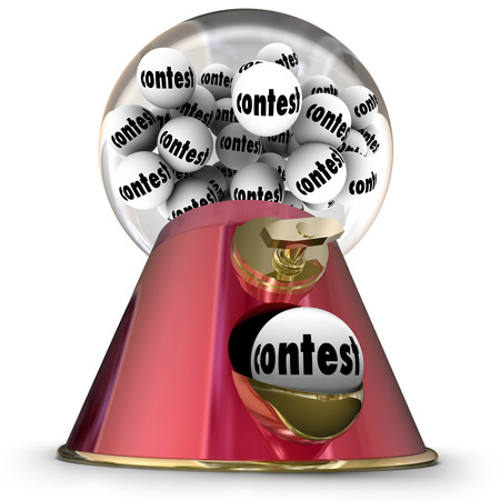 Contest word on gumballs in a machine or dispenser to illustrate being the lucky random winner of a prize, jackpot, game or challenge Stock Photo