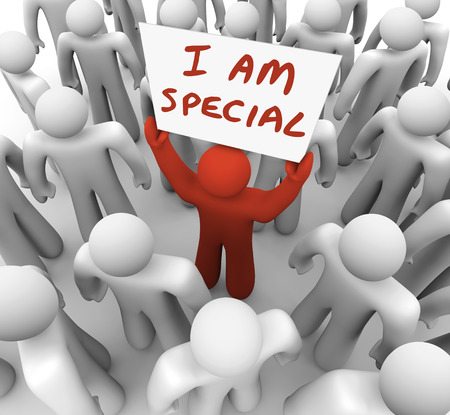 I Am Special words on a sign held by a man in a crowd standing out as different, unique, exceptional, rare or uncommon as the best choice to hire for a job, choose for an assignment or pick for a task