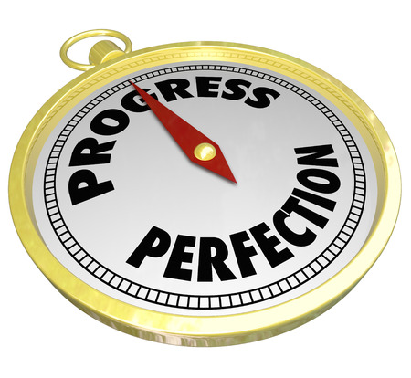 perfectionist: Progress gold compass pointing to forward movement and momentum and away from the drive for perfection which can often paralyze you from taking action and instead lead to procrastination Stock Photo
