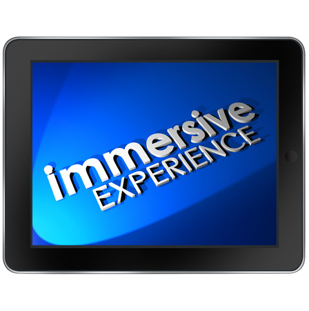 captivation: Immersive Experience words on tablet computer pad screen to illustrate an educational or entertainment viewing or use of the device Stock Photo