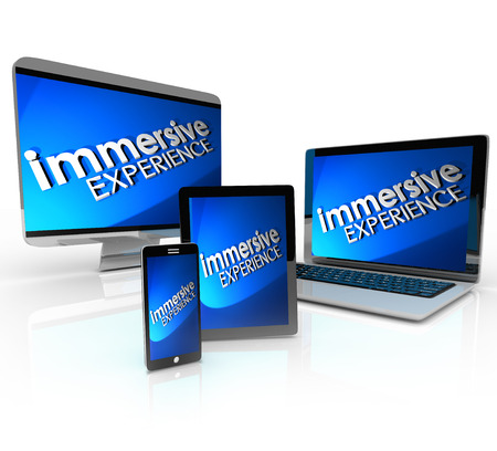 Immersive Experience words on screens or displays of a laptop and desktop computer, smart phone and tablet computer to illustrate educational or entertainment viewing involvement