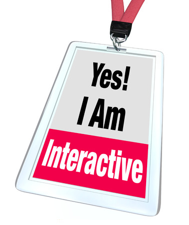 interactivity: Yes I Am Interactive words on a badge or name tag to illustrate someone who works together, participates or communicates in a group environment or experience Stock Photo