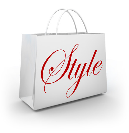 designer bag: Style word on a store shopping bag to illustrate shopping for clothes or other merchandise that is current with the latest trends and fashions Stock Photo