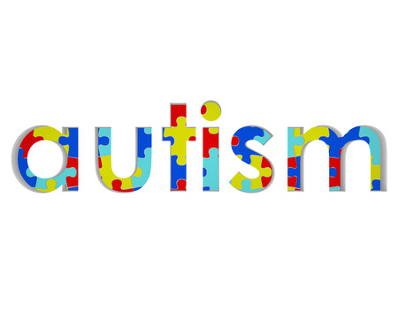 Autism word with colored puzzle pieces to illustrate hope and research for a cure for the neural disorder, disease or syndrome photo
