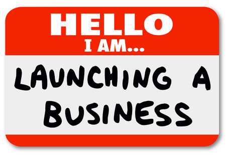 nametag: Hello I Am Launching a Business words on a nametag sticker to introduce yourself as an entrepreneur or company owner starting or beginning a new venture