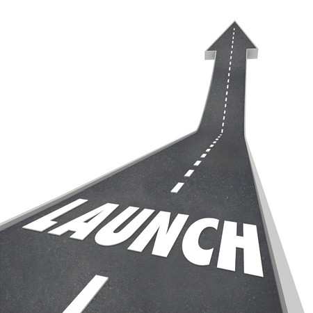 kick off: Launch word on a road or street with arrow pointing upward in the direction of success as you begin or start your new product, company or business Stock Photo