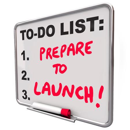Se preparan para lanzar palabras en una lista de tareas pendientes para recordarles la fecha límite para estar listo para iniciar o develar su nuevo producto, negocio, empresa o servicio Foto de archivo - 27689628