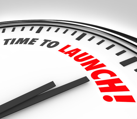 launch: Time to Launch words on a clock face to illustrate a countdown or deadline to start or unveil a new product, company, business or service