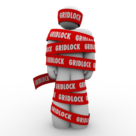 deadlock: Gridlock red tape wraped around a man or person who is trapped, stopped or prisoner to a challenge, adversity or bureaucracy Stock Photo