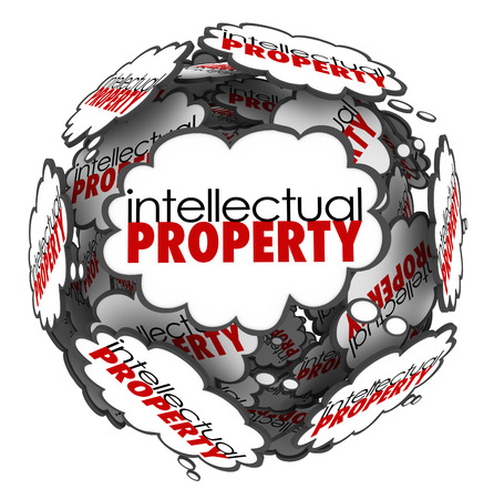 Intellectual Property words in thought clouds arranged in a ball or sphere to illustrate protected ideas and creations that are copyright or patented Stock Photo