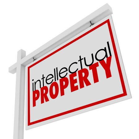 Intellectual Property words on a for sale or real estate sign to illustrate original, copyrighted or patented material for license or use by a third party Stock Photo
