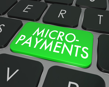 transactional: Micro Payments word on a computer keyboard button Stock Photo