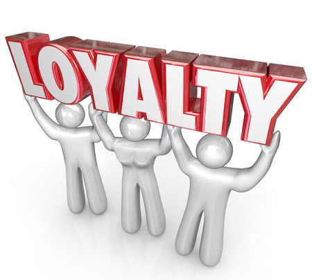 loyalty: Loyalty word lifted by team of workers or customers to illustrate devotion, dedication or faithfulness to your business or company