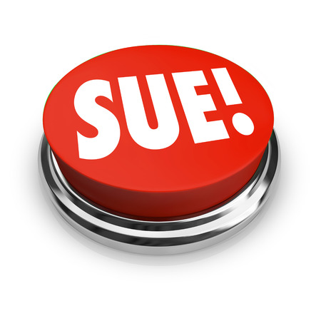 lawsuit: Sue word on a red round button to illustrate a plantiff taking a lawsuit against a defendant in a court of law to seek justice and damages