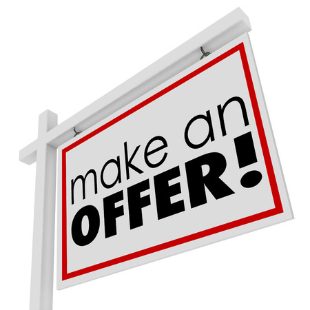 Make an Offer words for sale real estate sign to illustrate buying a home or house and negotiating a good price on your purchase photo