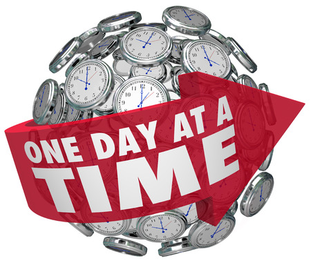 overcome a challenge: One Day at a Time words on an arrow around a sphere of clocks to illustrate moving forward steadily and slowly to overcome a challenge such as addiction