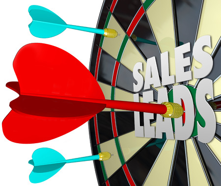 sales person: Sales Leads words on a dart board to illustrate selling to prospects and finding new customers for a business or company Stock Photo