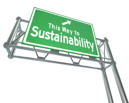 feasibility: This Way to Sustainability words on a green freeway sign to illustrate business practices that manage renewable resources for a viable long term plan that benefits everyone Stock Photo
