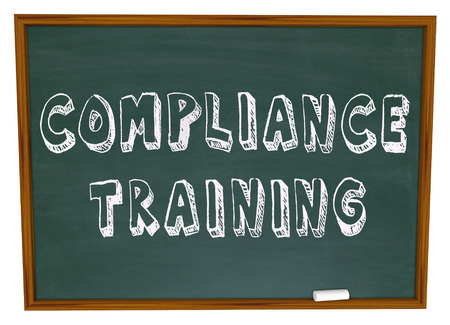 compliance: Compliance Training words on a school chalkboard to illustrate education and learning about following regulations, rules, guidelines and procedures for complying with laws