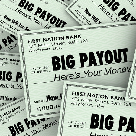 Big Payout word on many checks to illustrate a large pile of money and becoming rich or wealthy by cashing in your salary, commissions or lottery winnings photo