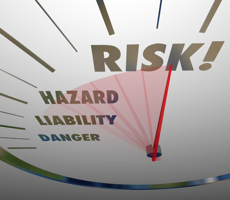 Risk, Hazard, Liability and Danger words on a speedometer measuring your level of danger, hazard and liability in business or life photo