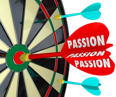 commitment committed: Passion word on a dart hitting a target on a board to illustrate concentration, desire, targeting a goal and achieving it