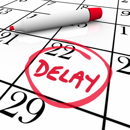 Delay word circled on a day or date on a calendar or schedule to illustrate a trip, meeting or appointment that has been pushed back 版權商用圖片