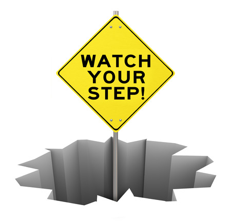 mitigate: Watch Your Step on a yellow warning sign sticking out of a huge hole, crack, chasm or pit to illustrate danger, caution, peril and risk that should be managed, prevented or avoided