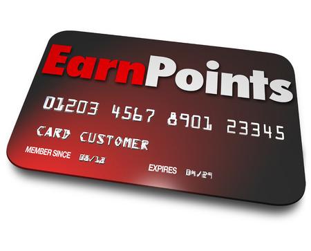 earn: Gane Puntos palabras en una tarjeta de cr�dito de pl�stico como el mejor programa de recompensas para ganar bonos en las compras de bienes en las tiendas Foto de archivo