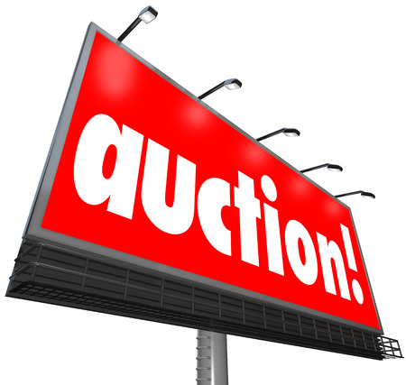auction win: Auction word on a billboard or sign to illustrate or advertise a special sale where bidders can win and purchase a home or other products being sold