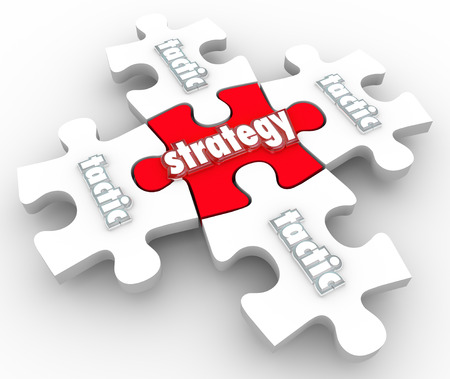 different strategy: Strategy and Tactics word on puzzle pieces to illustrate putting together a plan and excecuting or implementing it to achieve a goal or mission
