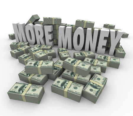 earn more: More Money words in stacks or piles of money - hundred dollar bills bundled to illustrate greater wealth, income, profits or revenue