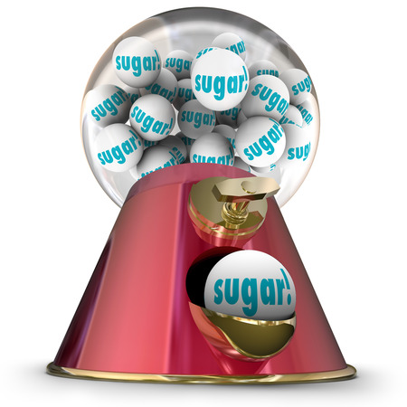 sugary: Sugar word on gum balls or candy dispensed by a gumball machine offering a sugary snack that will cause tooth decay and make you gain weight Stock Photo