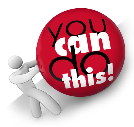 You Can Do This words on a ball being rolled up a hill by a man with self confidence and a positive attitude photo