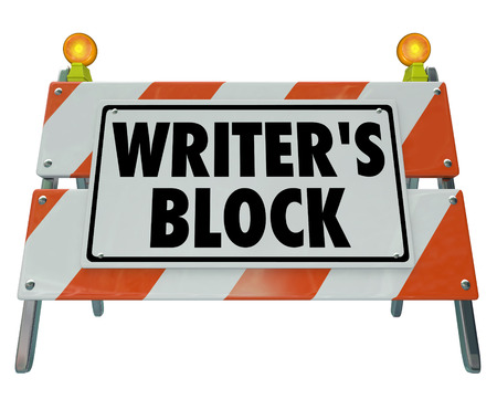 road block: Writers Block words on a barricade or road construction sign stopping you from making progress writing a novel, article essay or other form of communication youre unable to compose