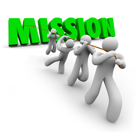 Mission word pulled up by a team of workers striving together to achieve a common goal, objective, job or task