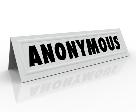 pseudonym: Anonymous word on name tent card to illustrate someone with a secret, classified, undisclosed, unknown, or nameless identity Stock Photo