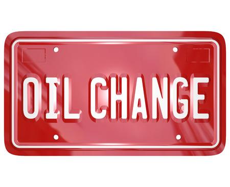 자동차 정비사 또는 차고 수리 공장에서 자동차 서비스를 설명하는 빨간색 번호판 오일 교환 단어