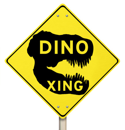 jurassic: Dino Xing words on a yellow warning road sign to represent dinosaur crossing, a fun park for children to play and learn about jurassic period of extinct creatures