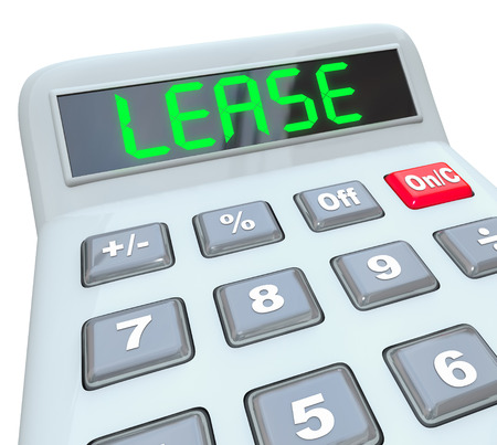 Lease word on a calcualtor display in digital letters to illustrate comparing the price or cost savings of leasing vs buying a car, home or apartment photo