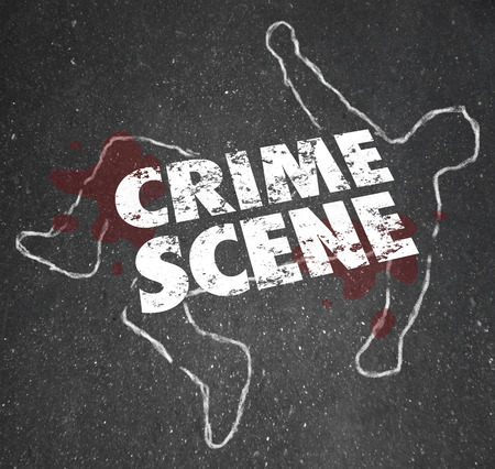 Crime Scene words on a chalk outline of a dead body or murder or homicide victim to close an area for investigation and keep the public away