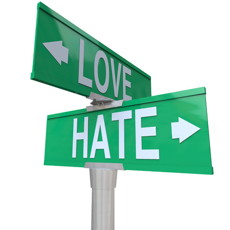 Love Vs Hate words on two way road signs pointing in opposite directions to illustrate complex relationships and changing feelings and emotions photo